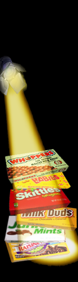 a stack of theater box candy in the spotlight