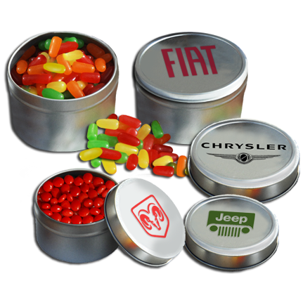 imprinted tin cans filled with Mike and Ike, Reeses Pieces and other candy
